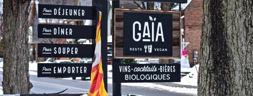 Sign for Gaia Bar on the street of bromont